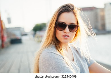 Lifestyle portrait of a young attractive woman outdoors