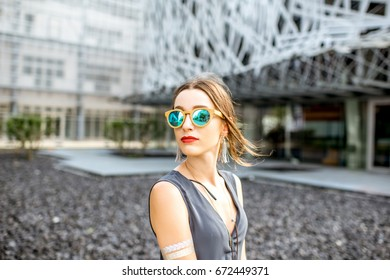 Lifestyle portrait of a young businesswoman standing outdoors at the modern office district