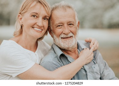 Lifestyle Senior Couple Happy and Relaxed . Good Healthy Elderly in Park Nature. Portrait Senior Retirement, Older Couple Enjoy Vacation Autumn. Celebrated Lover Valentine Day.