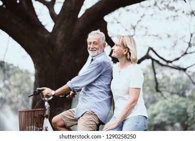 Lifestyle senior couple happy and relaxed . Good Healthy elderly in park nature. Group of Senior Retirement dancing and enjoy vacation summer
