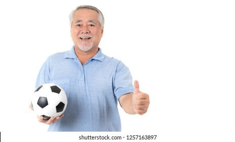 Lifestyle senior man feel happy holding football soccer ball prepare for Cheer team favorite isolated on white background