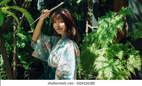 Lifestyle series: Asian woman in yukata holding paper fan