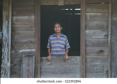 lifestyle of Southeast Asian people thailand.Old asian girl looking a camera form the window,poor asian woman in home.