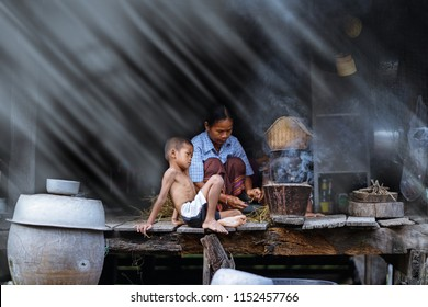 lifestyle of Southeast Asian people,Boy and mother in the field countryside thailand, mom and kid cooking in rural house,Southeast Asia