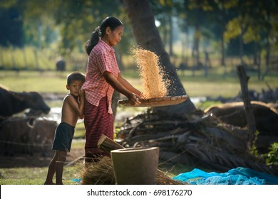 lifestyle of Southeast Asian people,Boy and mother in the field countryside thailand.