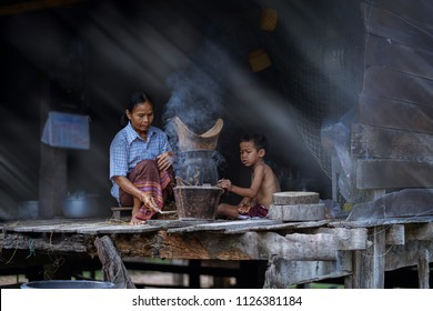 lifestyle of Southeast Asian people,mom and son in the home,countryside thailand, mom and kid cooking in rural house,Southeast Asia