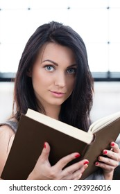 Lifestyle, study. Beautiful girl with a book