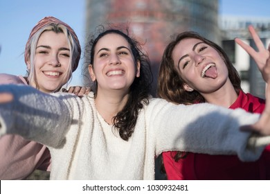 Lifestyle sunny image of best friend girls taking selfie on camera, crazy emotions , happy vacations, shopping day.