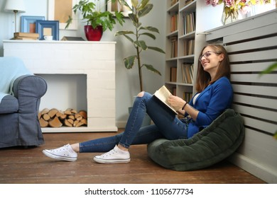 Lifestyle. Woman in blue jacket at home