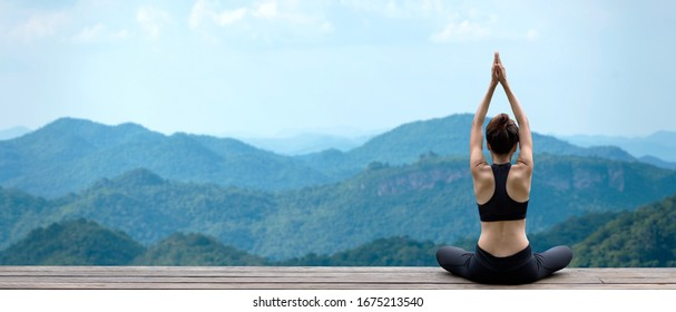 Lifestyle woman yoga exercise and pose for healthy life. Young girl or people pose balance body vital zen meditation for workout nature mountain background in morning sunrise with mat outdoor banner.