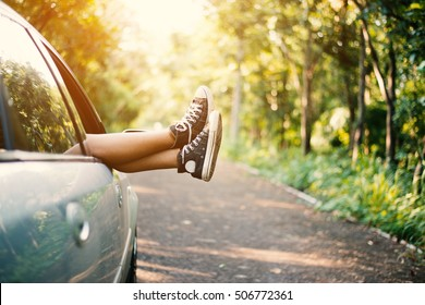 lifestyle woman,Vintage photo of woman's legs out of car windows