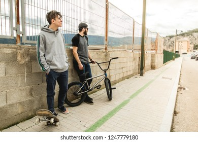 Lifestyle of young people with skateboard and bmx on the street