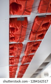Lifevest in passenger ferry. Safety orange floatation vest suspended in ceiling on boat.