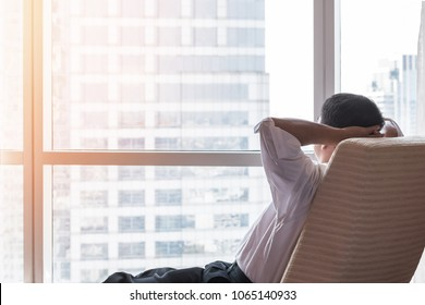Life-work balance and city living life style concept of business man relaxing, take it easy in office room resting with thoughtful mind thinking of lifestyle quality looking toward future vision