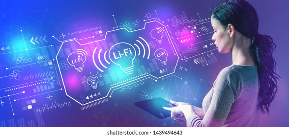 LiFi theme with business woman using a tablet computer