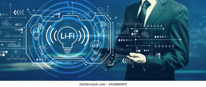 LiFi theme with businessman holding a tablet computer