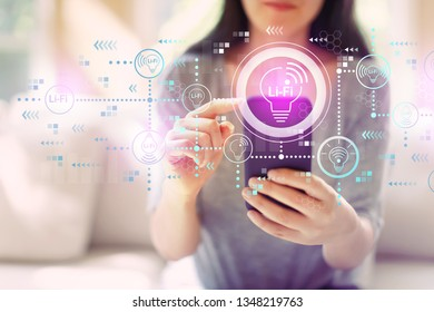 LiFi theme with woman using her smartphone in a living room