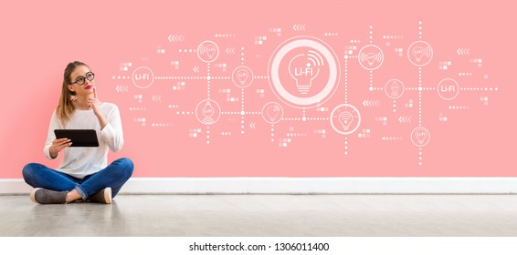 LiFi theme with young woman holding a tablet computer