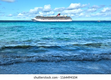 Lifou Island, French New Caledonia-07/21/2018. A view of the passenger ship Carnival Spirit taken from the beach. Lifou island is one of the several New Caledonia ports visited by this ship.