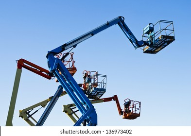 Lift buckets in the air against a clear blue sky.