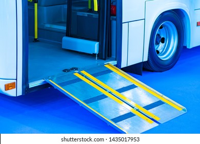 Lift for disabled people in a bus. Care of the invalids. Help to persons with disabilities. Access to transport for persons in wheelchairs. Accessible travel of disabled people. Passenger transport.