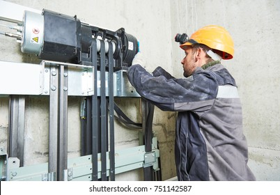 lift machinist repairing elevator in lift shaft