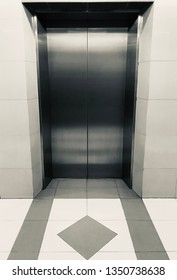 Lift vertical transportation device that moves people or goods between floors (levels, decks) of a building, vessel, or other structure.