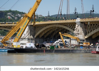 The Hableány was lifted from the Danube.A giant floating crane raises the boat from the river in Budapest after last month's fatal collision. Hungary, Budapest, 11.06.2019