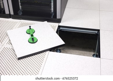 Lifted Datacenter Floor Tile With Vacuum Suction Cups In Datacenter