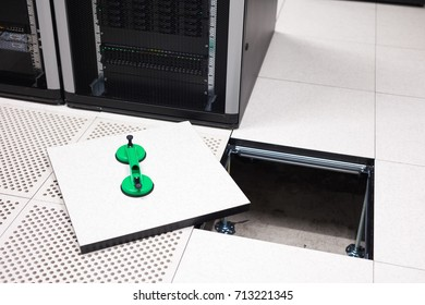 Lifted Floor Tile With Vacuum Suction Cups In Datacenter