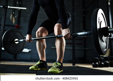 Lifting barbell in gym