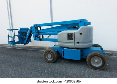 Lifting boom lift in construction site.