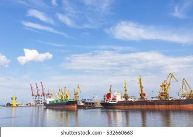 Lifting cargo cranes, ships and grain dryer in Sea Port of Odessa, Black Sea, Ukraine. Odessa Marine Trade Port is the largest Ukrainian seaport and one of the largest ports in the Black Sea basin