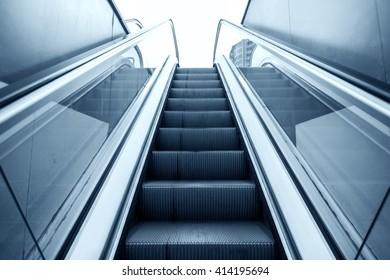 Lifting escalator. Toned image