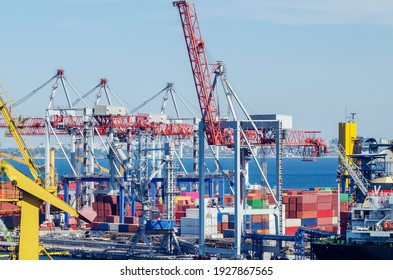 Lifting port cranes and sea containers in the cargo seaport.
