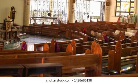LIGAO, ALBAY / PHILIPPINES - MARCH 30, 2019: Wooden chairs at the Divine Mercy Shrine, the church near Kawakawa Hills Natural Park
