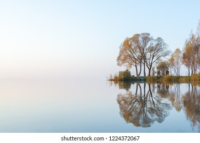light autumn mist over the lake hides the perspective and the far shore and turns the water and the sky into a single entity.  Lake Plesheevo in Pereslavl-Zalessky