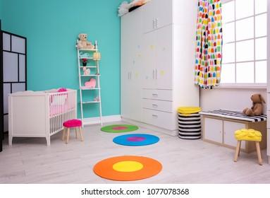 Light baby room interior with crib