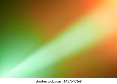 Light beam of light on a light green orange and a setle orange background