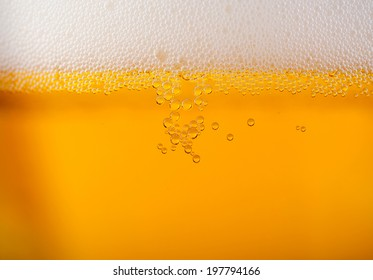 Light beer background close up with foam