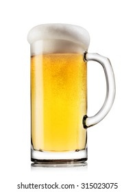Light beer with the foam in mug isolated on a white background