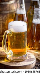 Light beer in a glass, on an old background. - Shutterstock ID 1930658765