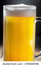 Light beer in a glass, on an old background.
