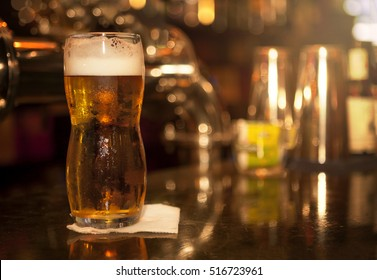 Light beer in glass on the table