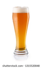 Light beer IPA with foam in glass with beautiful color gradient. isolated