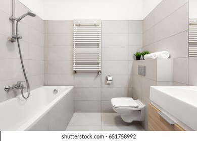 Light beige bathroom with bathtub and countertop basin