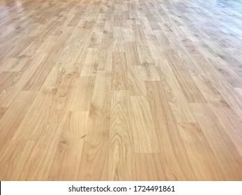 Light beige brown wood pattern vinyl floor texture background