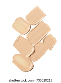 Light beige smear of crushed highlighter or luminizer isolated on white background. Makeup smear of creamy foundation isolated on white background. Creamy foundation texture isolated on white