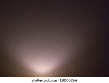 Light from below on violet soft color wall interior background.