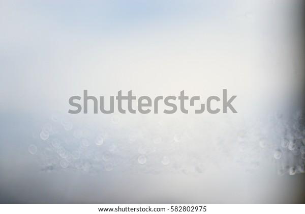 light blue background bokeh drops glass, blurred